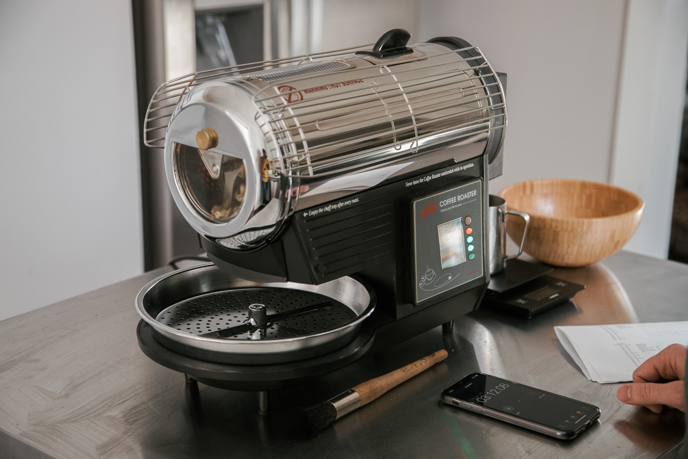 A Hottop Coffee Roaster in a kitchen with a Apple iPhone X R keeping track of the time.
