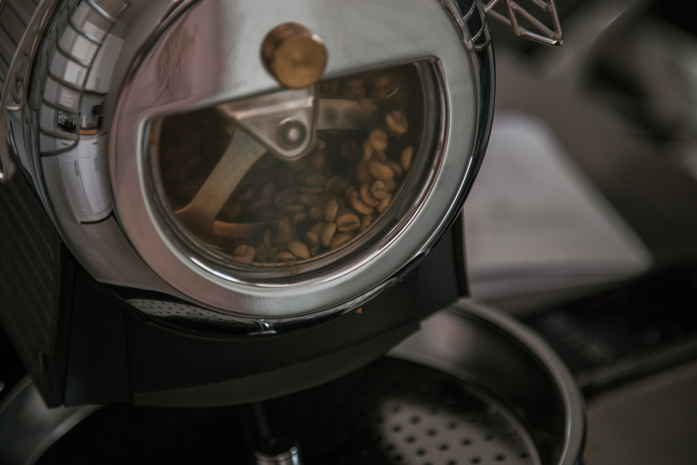 A closeup of the Hottop Coffee Roaster's roasting chamber, showing what the beans look like when they turn yellow.