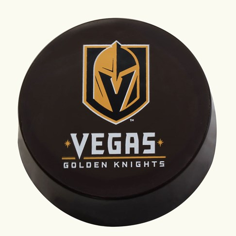 Ethel_M_Chocolates_Vegas_Golden_Knights_Pure_Dark_Chocolate_Hockey_Puck_Overhead_View_Unpackaged