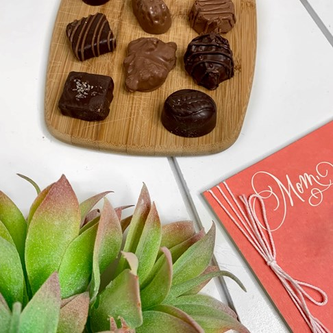 Ethel_M_Chocolates_Assortment_On_Cutting_Board_Overhead_View