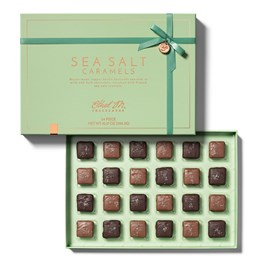 open box of sea salt caramels 24 piece with lid and chocolate tray