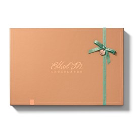 Mix and Match chocolate pieces with our reimagined packaging with complementing colored satin ribbons and charm sealed with Ethel M's monogram.