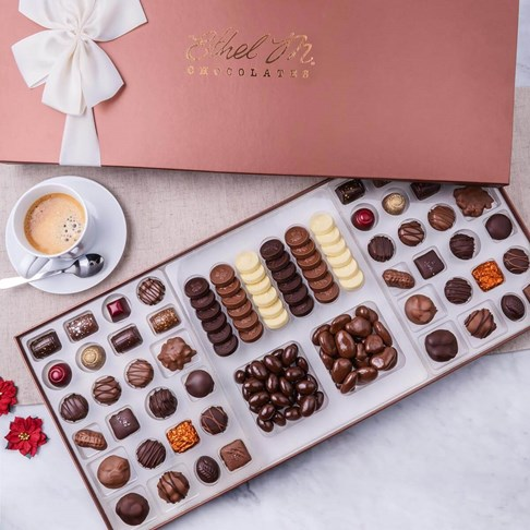 Our Centerpiece Collection, 80 pieces of chocolate including liqueurs, caramels, satin cremes, coins, and nuts. Ethel M Chocolates Biggest Box Ever!
