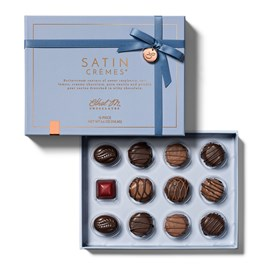open box of satin cremes 12 piece collection