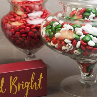 Personalized M&M'S for Christmas in jar next to solid red M&M'S in jar - Christmas themed