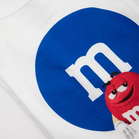 "Ladies M&M'S Filled M Logo Tee, Up Close View of White T-Shirt with Blue Circle, Inside Circle is a White ""m"" Logo & Red Character"