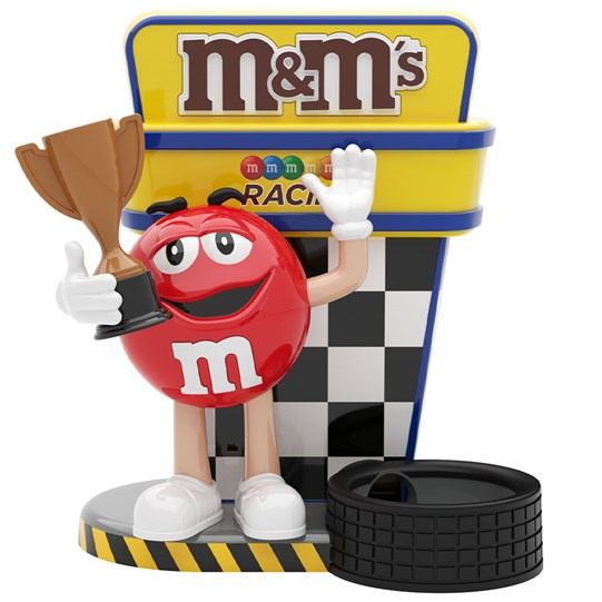 M&M'S Racing Dispenser, Front View of Red M&M'S Character Holding a Trophy at Race.