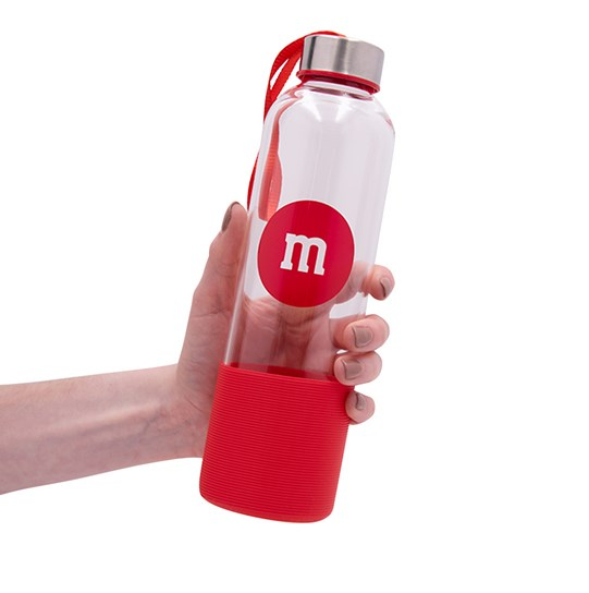 "M&M'S Glass Bottle with Silicone Bottom, Scale View of Glass Bottle with ""m"" Logo & Silicone on Bottom for Size"