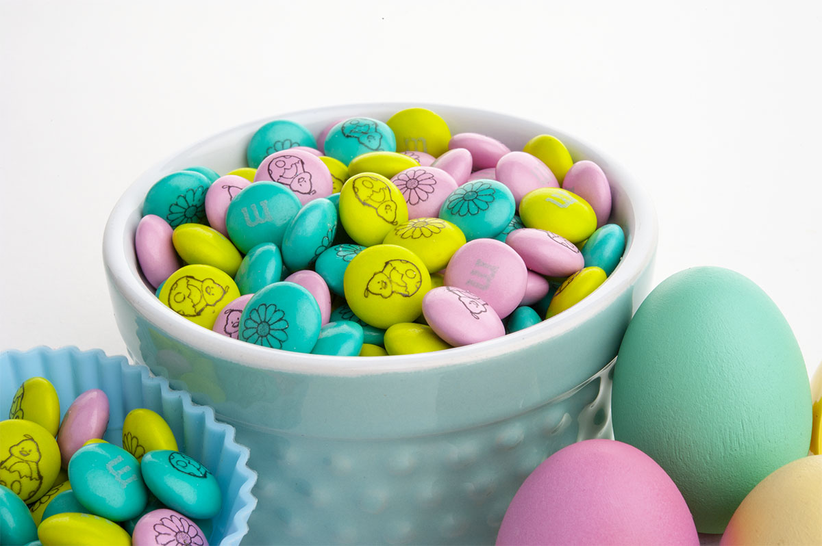 Personalized Easter candy in a pot next to Easter eggs
