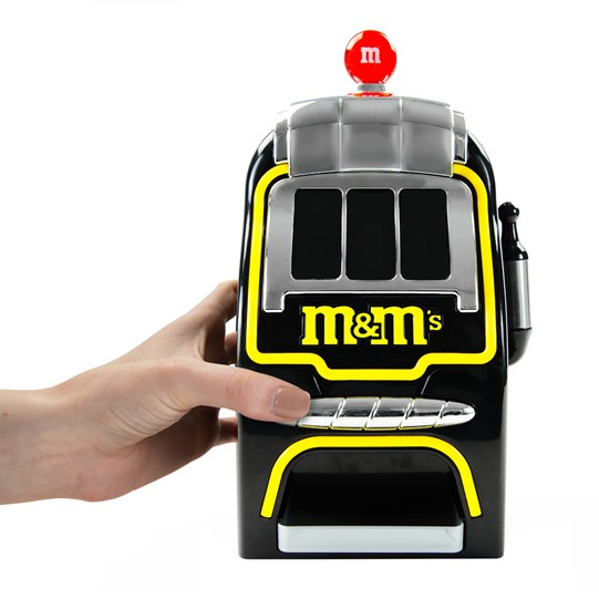 Hand shown with Digital Slot Machine M&M'S Candy Dispenser for size representation