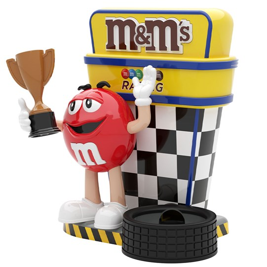 M&M'S Racing Dispenser, Side View of Red M&M'S Character Holding a Trophy at Race.