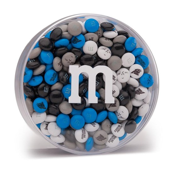 "Carolina Panthers NFL Round Gift Box, Front View of Round Acrylic with ""m"" logo on outside, filled with Panthers M&M'S"