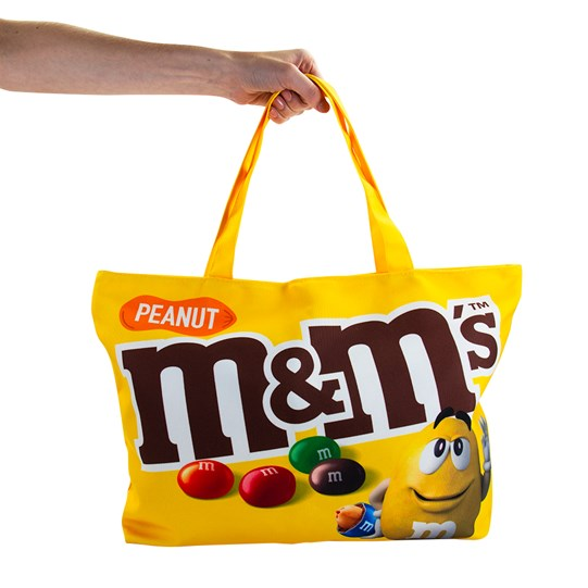 Hand holding M&M'S Chocolate Tote Bag