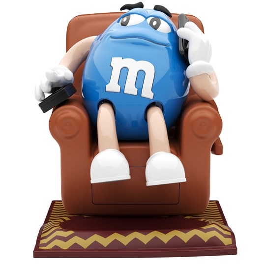 M&M'S Recliner Dispenser, Front View of Blue M&M'S Character Lounging on Chair Holding TV Remote.