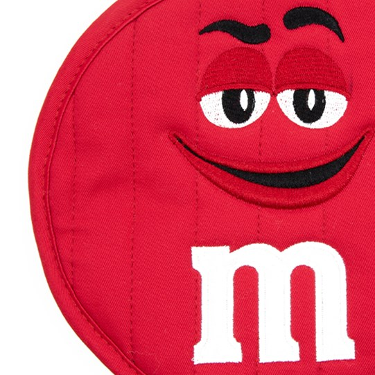 "M&M'S Character Big Face Round Pot Holder, Up Close View of Pot Holder Showing Character Face and White ""m"" Logo Detail"