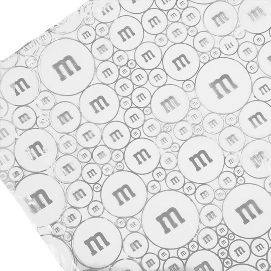 M&M'S M Logo Print Poncho in Ball, Up Close View of M&M'S Design on Poncho