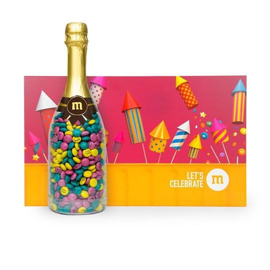 Personalizable M&M'S Occasion Bottle next to Let's Celebrate Gift Box