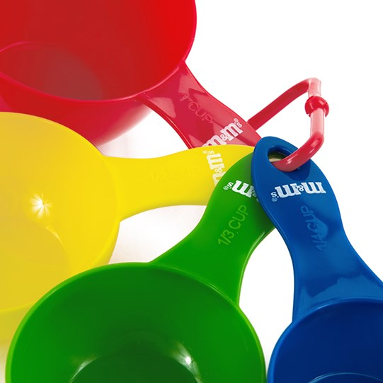 M&M'S Measuring Cups, Up Close View of All 4 Measuring Cups in Red, Yellow, Green & Blue Showing M&M'S Logo Detail