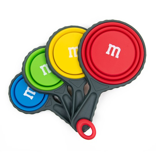 "M&M'S Collapsible Measuring Cups, Alt View of ""m"" Logo in White on Back of Red, Yellow, Green & Blue Measuring Cups"