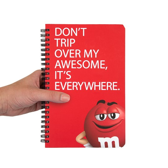 Hand holding M&M'S Humor Character Notebook