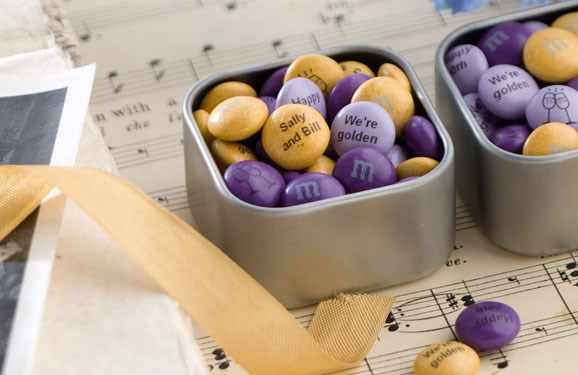 Purple, light purple and gold personalized M&M'S in small metal tins with gold ribbon and a wedding photo
