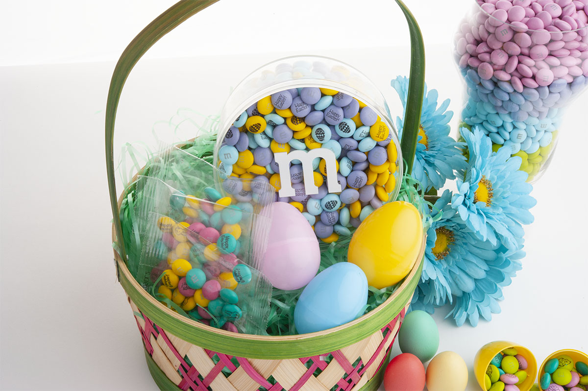 Personalized Easter candy inside M&M'S gift container and in an Easter basket with colored eggs