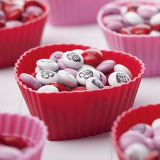 Valentine's day party cups filled with personalized M&M'S
