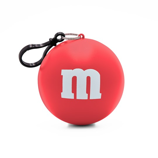 "M&M'S M Logo Print Poncho in Ball, View of Outside Packaging, Shows Ball with White ""m"" Logo and Keychain"