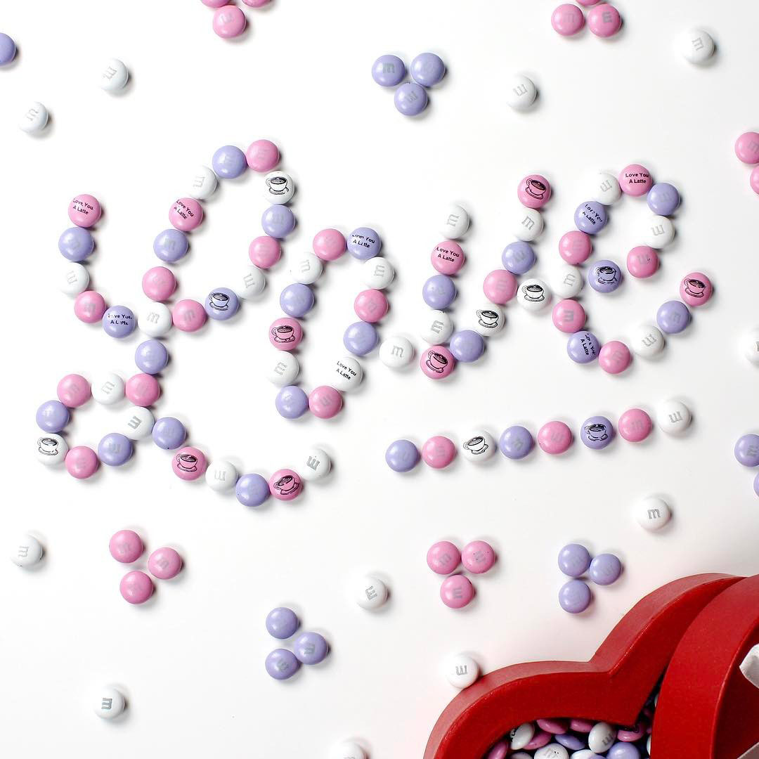 Personalized M&M'S spelling out the word LOVE on a white background