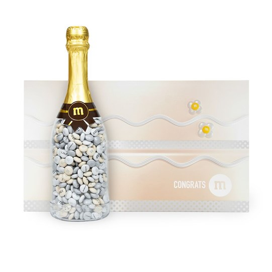 Personalizable M&M'S Occasion Bottle next to Wedding Gift Box