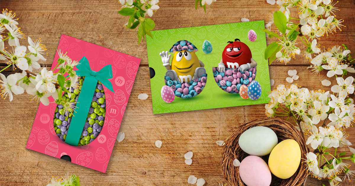 Personalized M&M'S in Easter themed gift boxes next to colored eggs