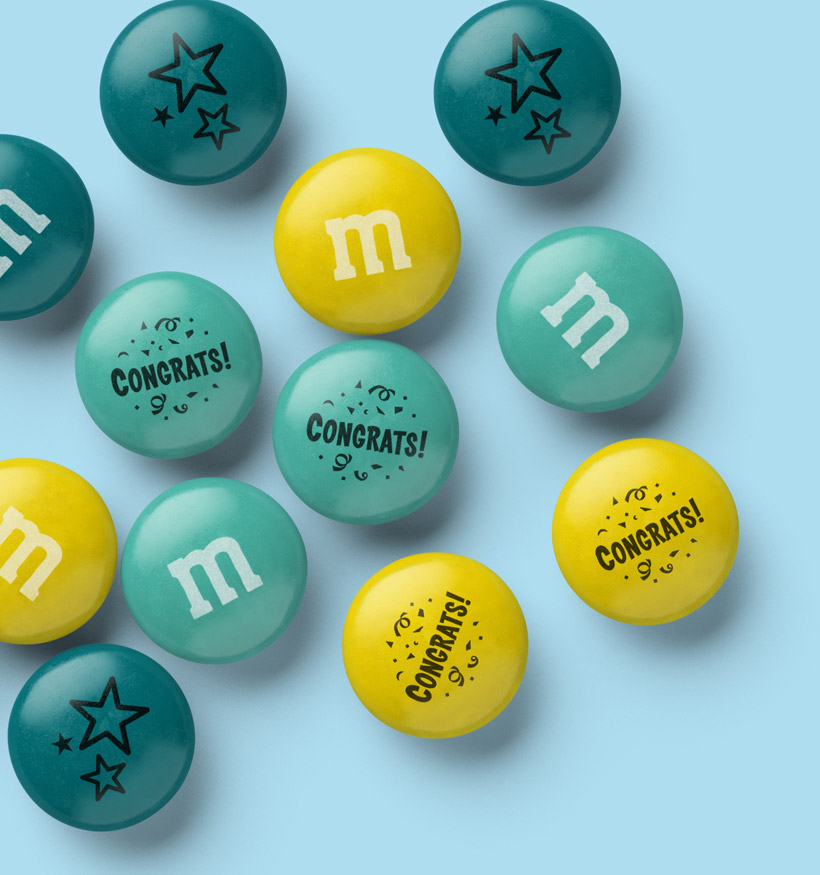 A spill of Congrats themed personalized M&M'S