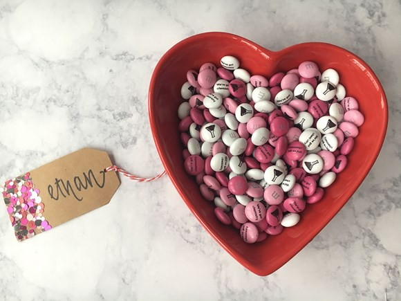 Personalised Valentine's Day gift M&M'S in a red heart shaped serving dish with a gift tag attached