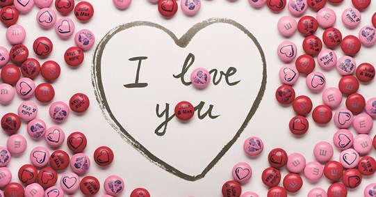 "Personalised Valentine's Day gift M&M'S on a white background with the words ""I love you"""