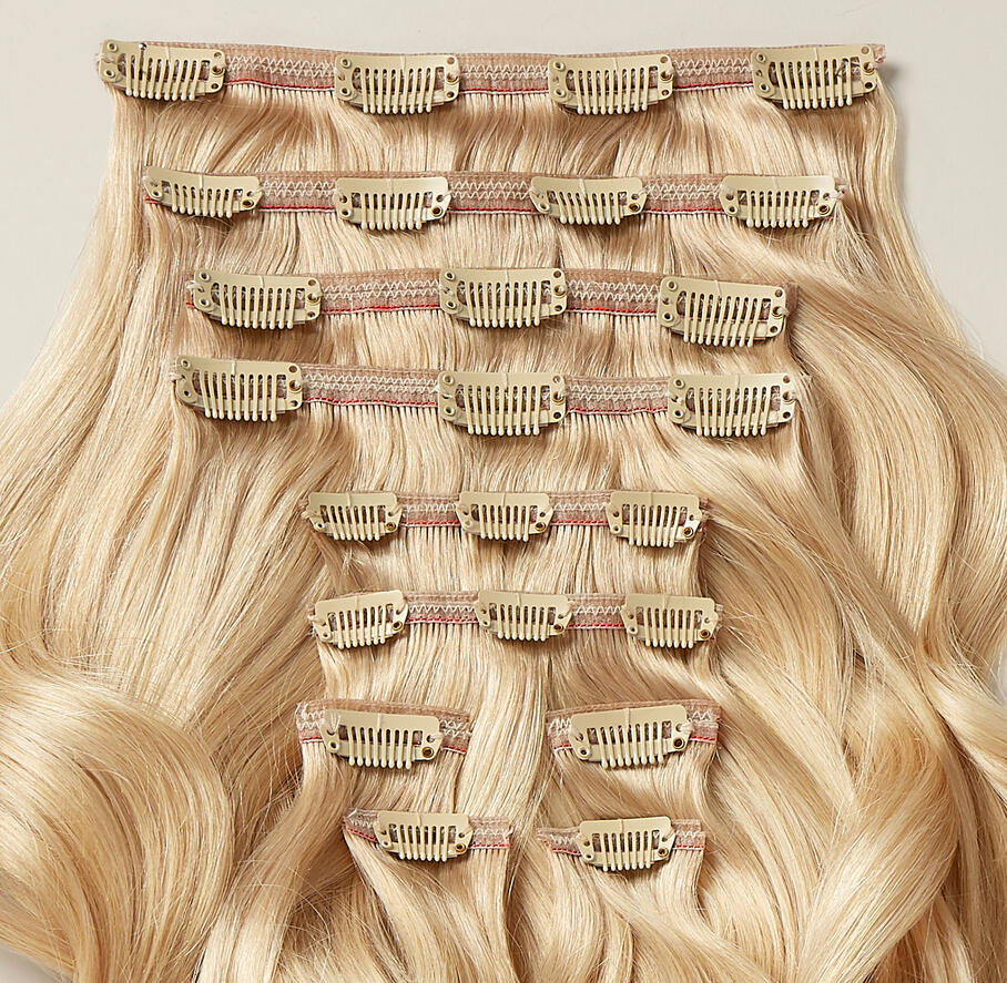 Close-up of a 10 piece set of Beyond hair extensions clip side up